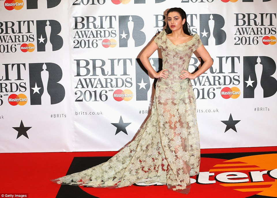 Quirky queen:Charli XCX opted for her signature quirky style for the evening. The Boom Clap hitmaker wowed in a vintage long dress - complete with a flowing train that fell behind her on the red carpet - and an off-shoulder corsted style to show off her trim waistline