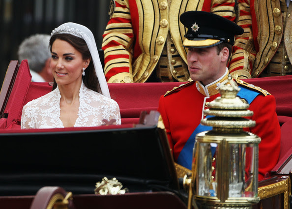 Their Royal Highnesses Prince William Duke of Cambridge and Catherine Duchess of Cambridge make the journey by carriage procession to Buckingham Palace following their marriage at Westminster Abbey on April 29, 2011 in London, England. The marriage of the second in line to the British throne was led by the Archbishop of Canterbury and was attended by 1900 guests, including foreign Royal family members and heads of state. Thousands of well-wishers from around the world have also flocked to London to witness the spectacle and pageantry of the Royal Wedding.