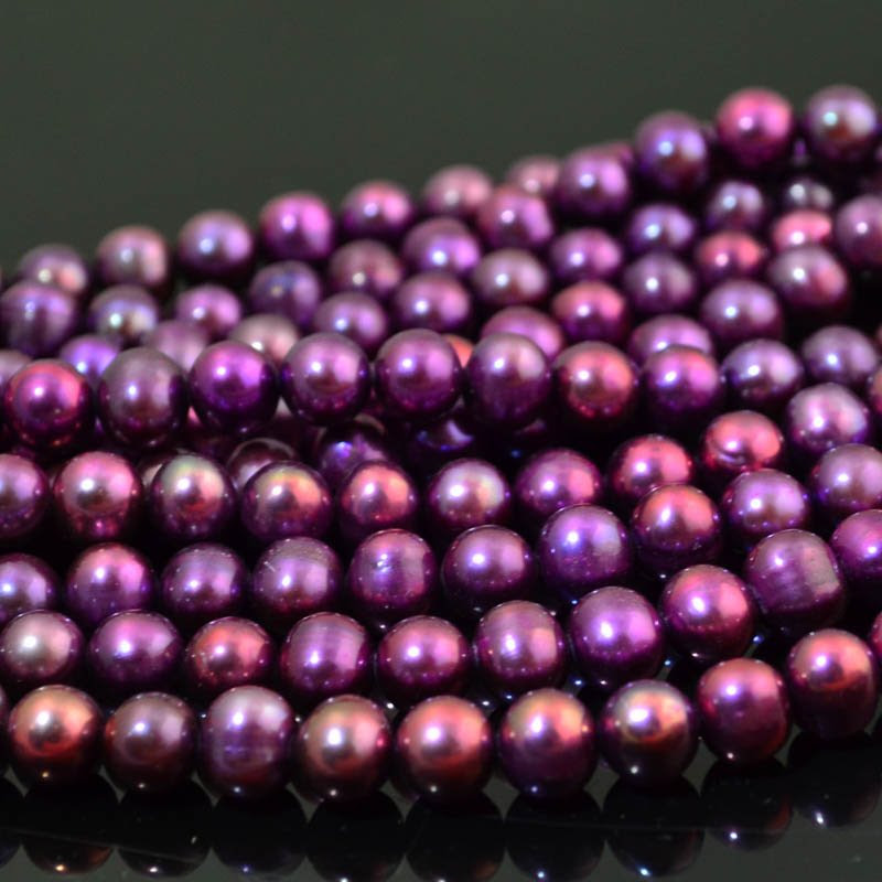 s6714 Freshwater Pearls - 8 x 7.7 mm Near Round Pearl - Berry Purple (strand)