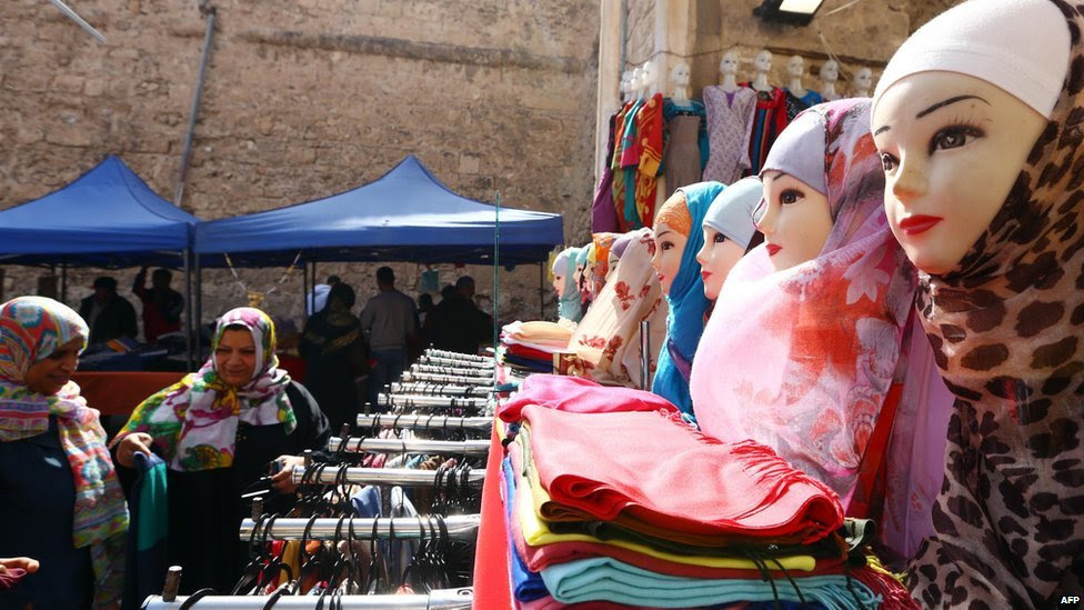 Libyan women shop in the old part of the capital, Tripoli, on 17 March  2015