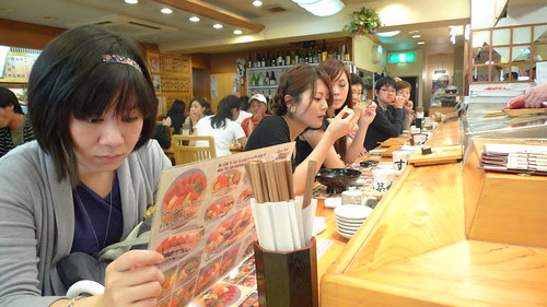 Yuan Yue looks at the menu