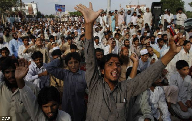 Pakistan anger: demonstrators in Karachi chant slogans condemning the killing of Osama bin Laden as they gather to offer funeral prayers