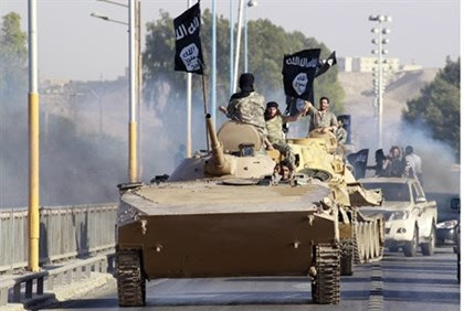 ISIS fighters parade in Raqqa, Syria