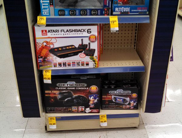 Classic Atari and Sega Genesis game consoles on sale at my local Walgreens store...on November 15, 2015.