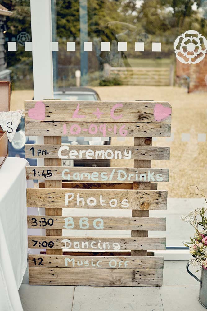Pallet Wood Wedding Time Table at Tudor Barn, Belstead Wedding - www.helloromance.co.uk