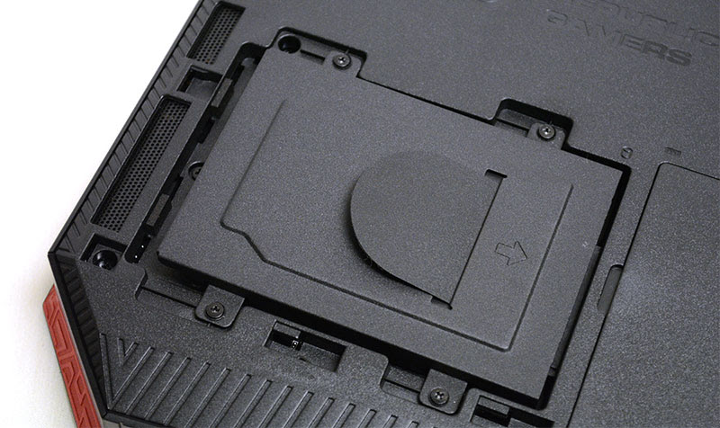 A closer look at the storage expansion bay, and the four screws you'll need to remove.