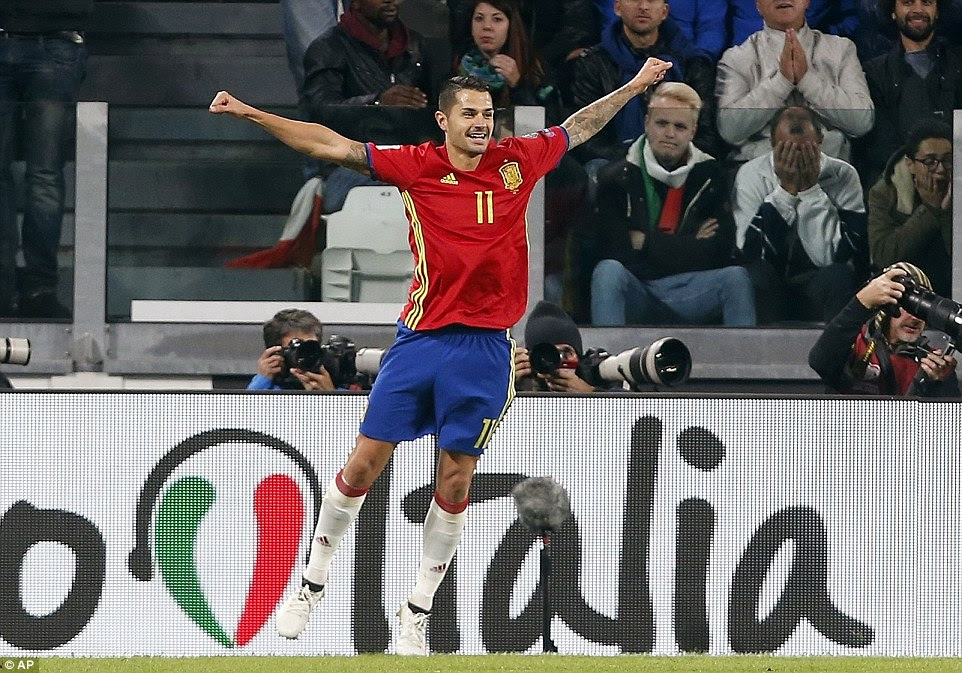 Vitolo celebrates opening the scoring for Spain with a composed finish in the second half