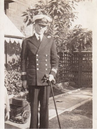 Peter Harrison's father, Dr Leo Harrison, posing for a portrait in his Naval uniform