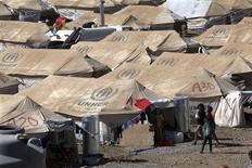 Un grupo de sirios en un campo de refugiados en Arbil, Iraq, ago 26 2013. El número de refugiados sirios ha superado la marca de los dos millones, dijo una agencia de Naciones Unidas el martes, advirtiendo que el mundo enfrenta su peor amenaza a la paz desde la guerra de Vietnam. REUTERS/Azad Lashkari