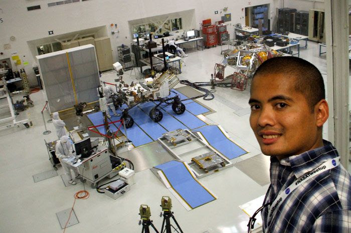 Posing with the Curiosity Mars rover and its descent stage behind me, at NASA's Jet Propulsion Laboratory on June 6, 2011.
