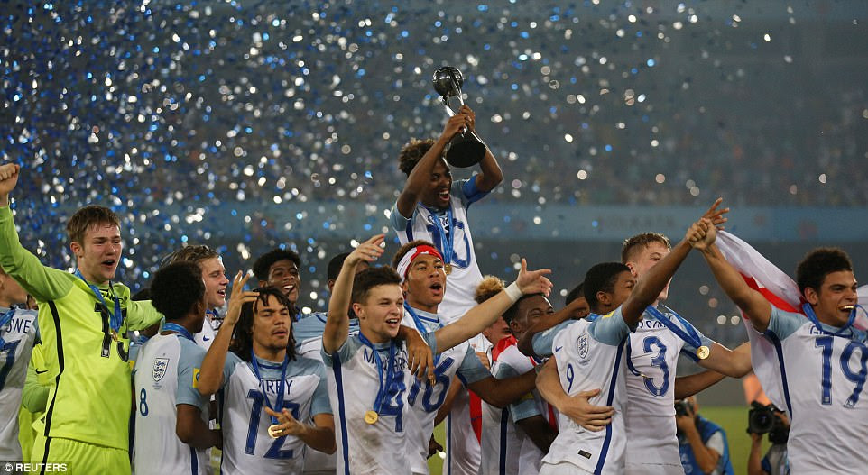 England parade their trophy at the Salt Lake Stadium in Kolkata following a momentous comeback win over Spain