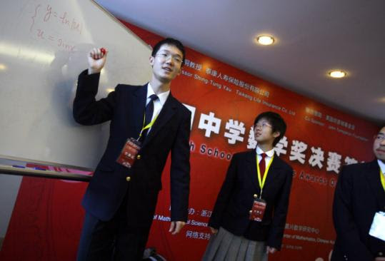 Students Li Taibo and Zhao Xinyue sought the attention of US admissions deans at a Beijing math competition.