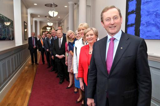Enda Kenny preparing to lead his new cabinet into the Dail chamber