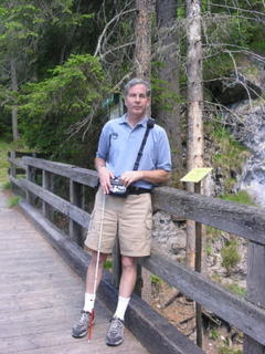 Mike standing on a bridge