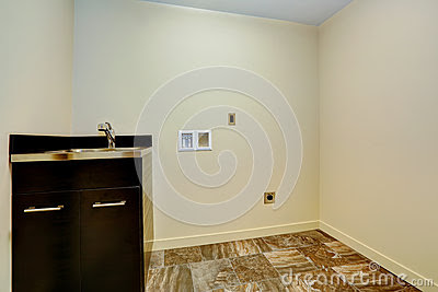 Empty New Laundry Room With Sink And Cabinet. Stock Photo - Image
