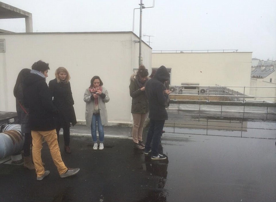 A picture posted on Twitter appearing to show people taking refuge on the roof of the Charlie Hebdo office