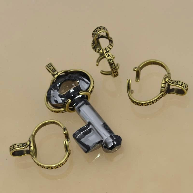 s36355 Findings - Bail - Large Swarovski Key Bail - Antiqued Brass (1)
