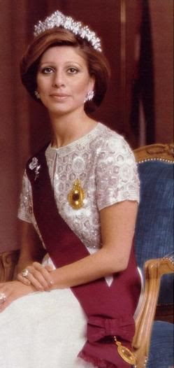 The late Queen Alia, Jordan, third wife of the late King, wearing a modern diamond tiara and earrings by Cartier: