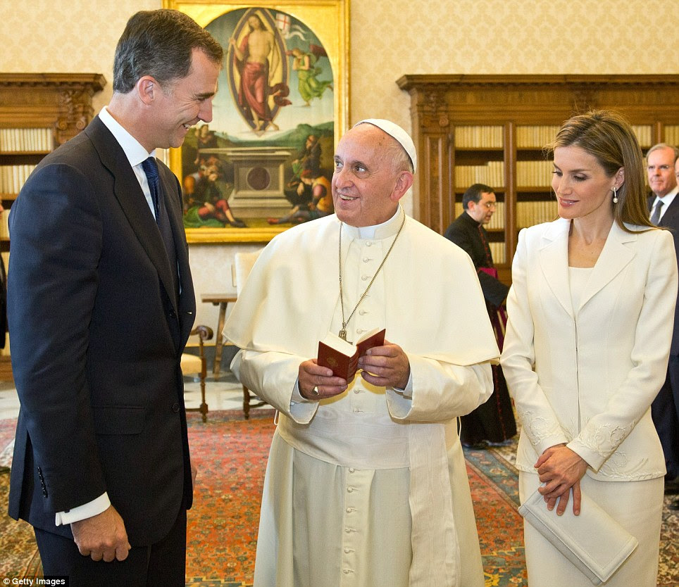 Pope Francis looks up at Spain's King Felipe VI, as Queen Letizia looks on, at a meeting at the pontiff's library in the Apostolic Palace in the Vatican City