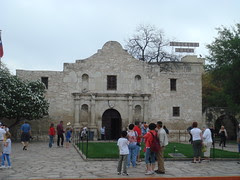 Alamo with Crockett Hotel sign in back