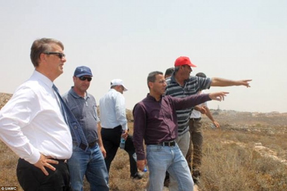 Aid donor: Peter Mollema, Holland's Head of Mission, surveys Palestinian buildings on the West Bank