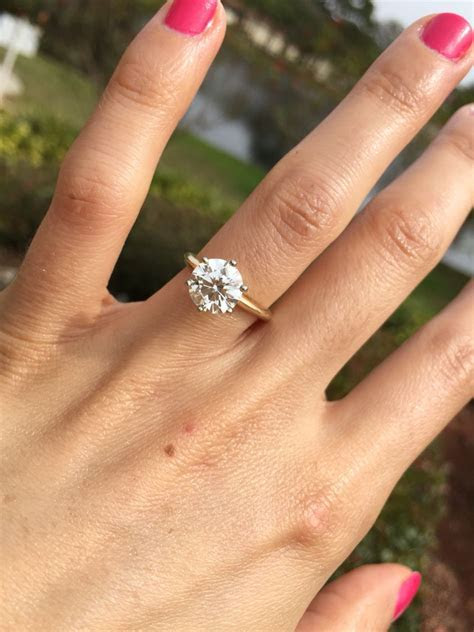 My engagement ring! Round brilliant solitaire 6 prong 14k