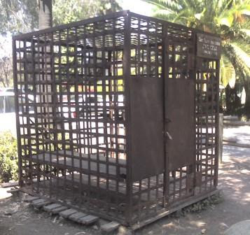 Photo of cage-like holding cell