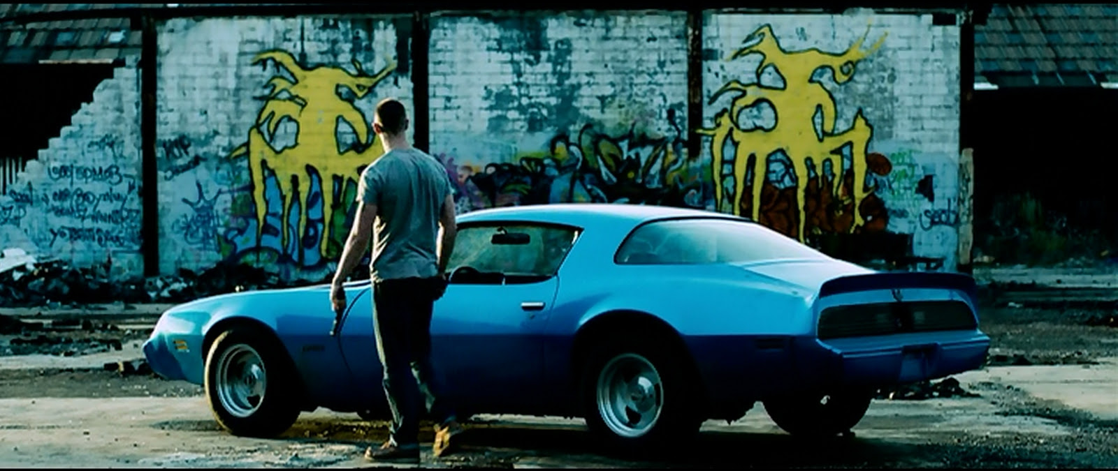 Guns, ruins, and a muscle car: the most Detroit picture you will ever see outside of Robocop.
