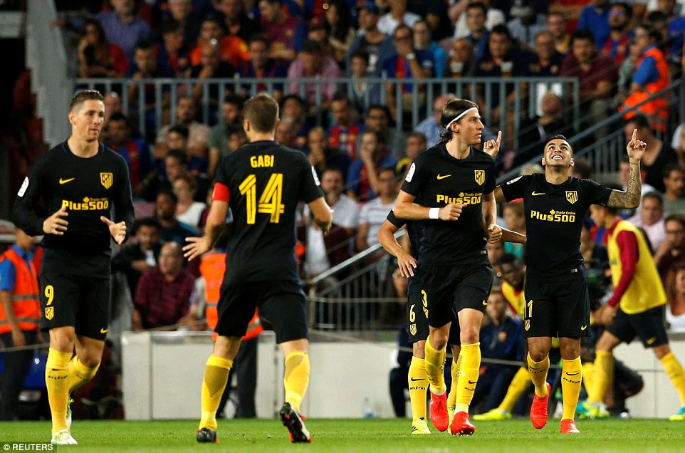 Correa (right) points to the sky in celebration as the rest of his Atletico team-mates return to their half following his goal