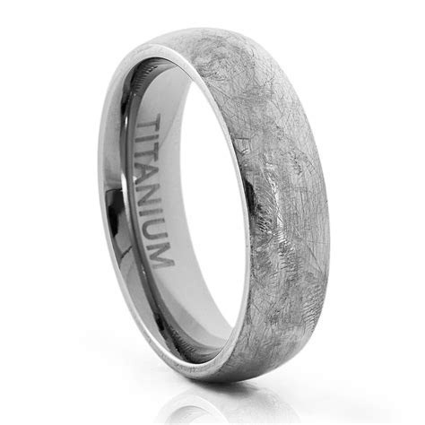 How to refinish a scratched titanium wedding band.   If