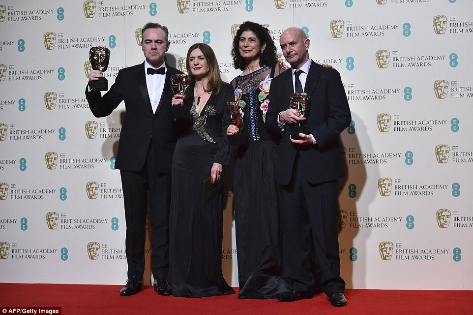 The behind the scenes heroes:(L-R) Irish director John Crowley, New Zealand producer Finola Dwyer, British producer Amanda Posey and British author and screenwriter Nick Hornby pose with their awards for an outstanding British film for Brooklyn