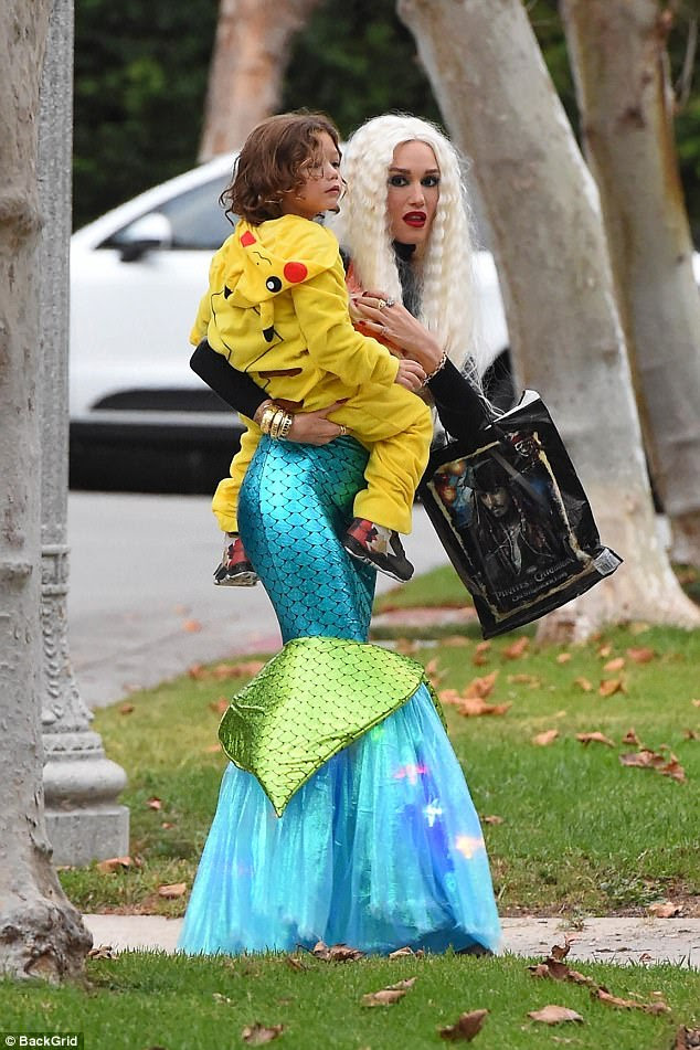 Trick or treat!Her children were dressed up as Pikachu, and Gwen sweetly carried her youngest son against her hip as they made the rounds through the neighborhood