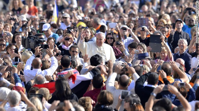 Pope Francis greets the crowd as he arrives for his general audience at St. Peter's Square at the Vatican on Wednesday, October 8. With his penchant for crowd-pleasing and spontaneous acts of compassion, the Pope has earned high praise from fellow Catholics and others since he replaced Pope Benedict XVI in March 2013.