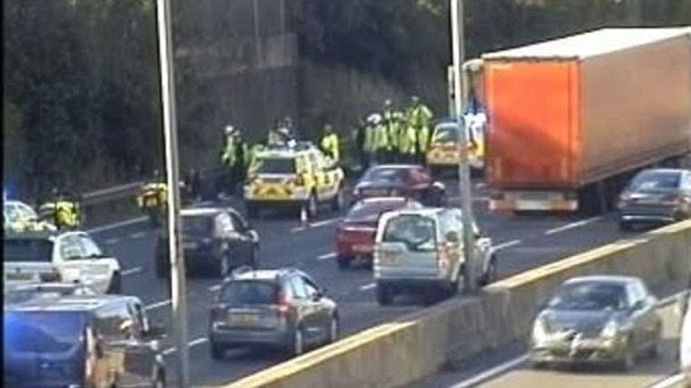 A number of officers attended and detained 16 people after the lorry was stopped just before junction 11, police said