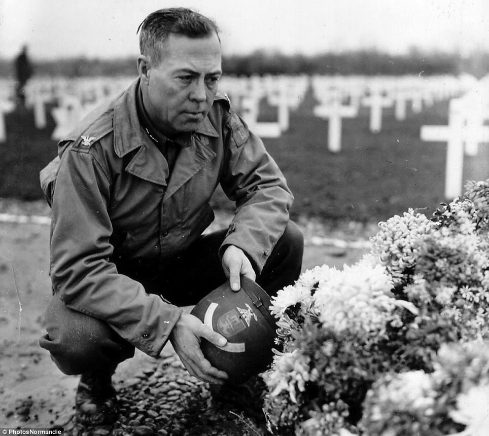 Contemplation: Colonel William D. Bridges of the 5th Engineer Special Brigade pauses in front of a temporary cemetery