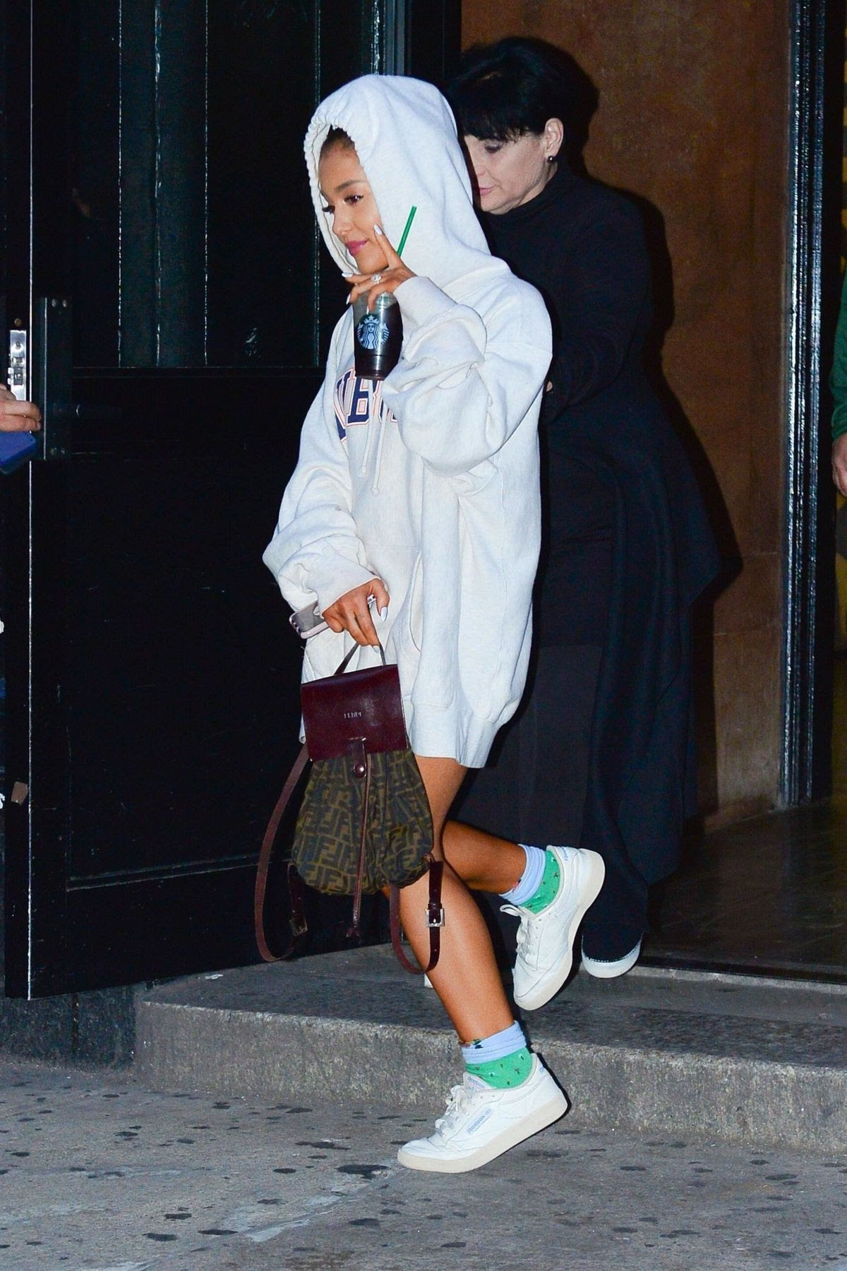ariana grande tip toes in tennis shoes leaving studio in