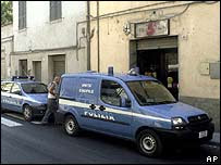 Police cars stand outside the Ponte Felcino mosque