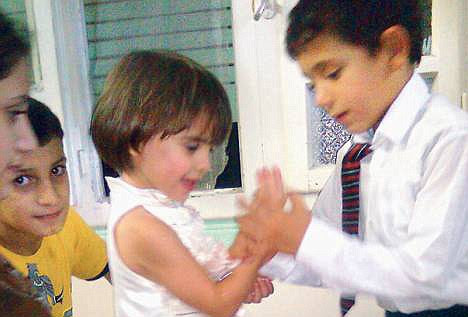 Love sick: Khalid, shown here exchanging rings with Hala, refused to go back to nursery as he was missing his girlfriend, who he met on holiday