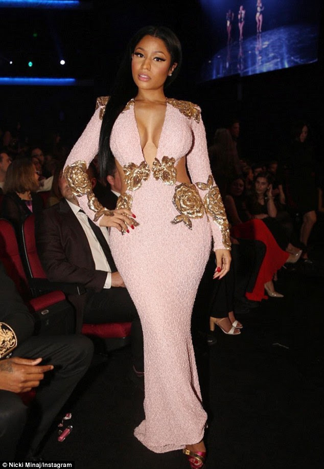 Showstopping: The 32-year-old rapper showcased her killer curves in a soft pink gown with gold embellishments