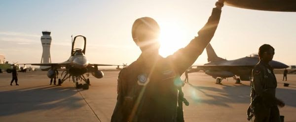 Carol Danvers (Brie Larson) and Maria Rambeau (Lashana Lynch) prepare to board their fighter jets at a U.S. air force base in CAPTAIN MARVEL.