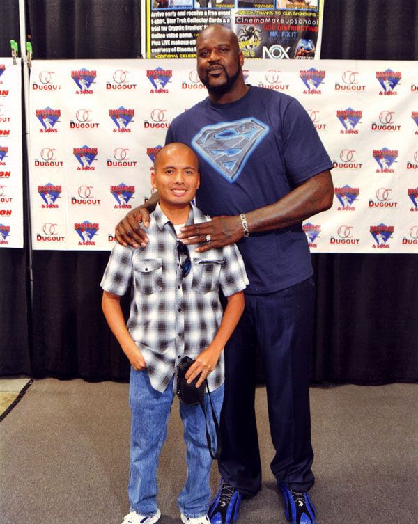 Posing with Shaq at the Frank & Son Collectible Show in City of Industry, California...on August 10, 2013.