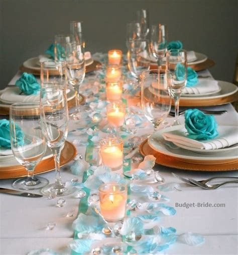 Teal wedding table with turquoise tipped rose petals and