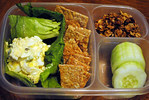Egg Salad on lettuce with homemade Wheat Crackers. Homemade Granola and cucumber rounds. A thermos of milk, some grapefruit, and a cloth napkin added to cooler. Thanks to Michelle of All Home Cooking http://bit.ly/9LpjH5 for sharing this!