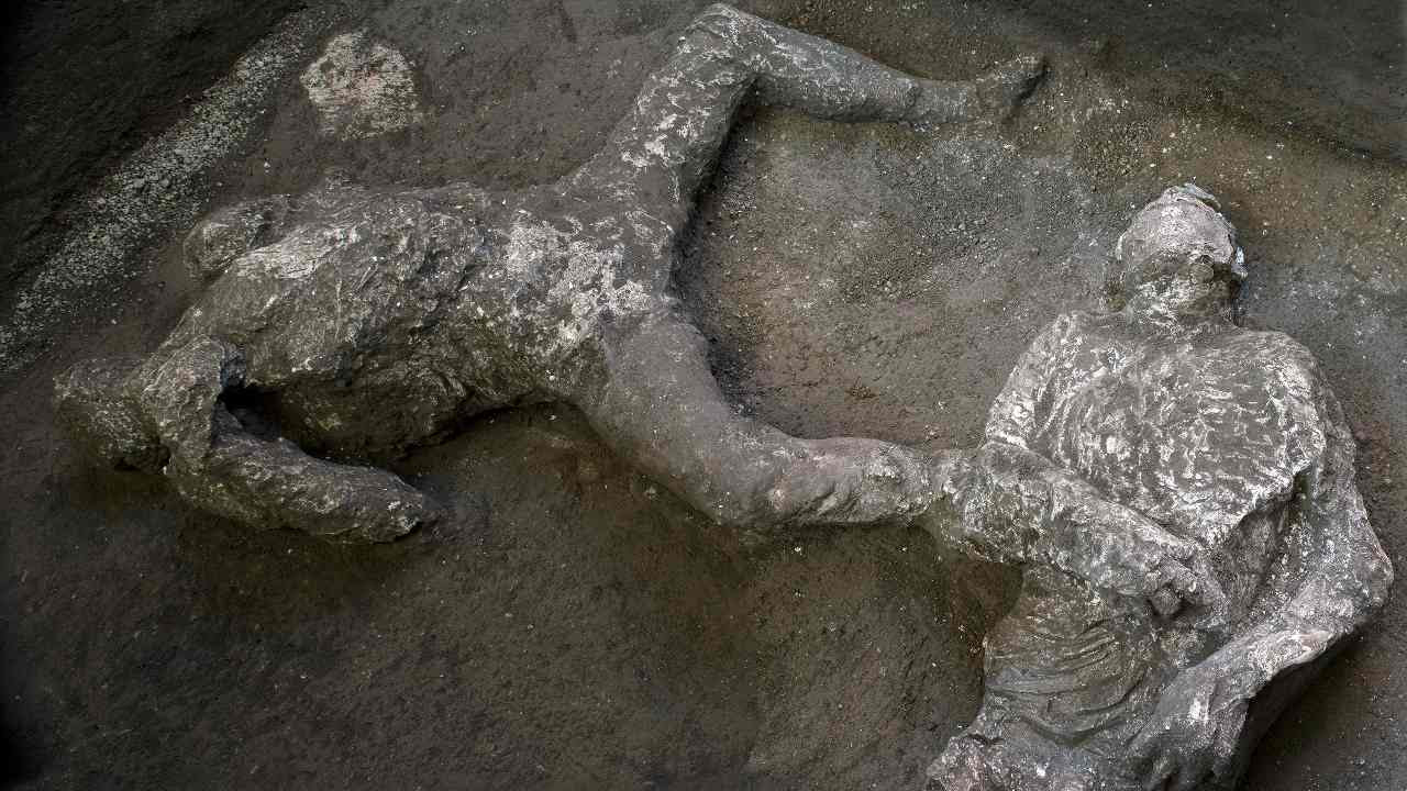 The casts of what are believed to have been a rich man and his male slave fleeing the volcanic eruption of Vesuvius nearly 2,000 years ago, are seen in what was an elegant villa on the outskirts of the ancient Roman city of Pompeii destroyed by the eruption in 79 A.D., where they were discovered during recents excavations, Pompeii archaeological park officials said Saturday, Nov. 21, 2020. Image credit: Parco Archeologico di Pompei via AP