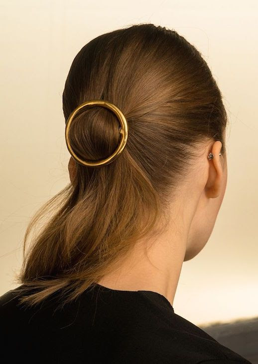 Le Fashion Blog 15 Ways To Wear Round Circle Hair Clip Pin Accessory Hairstyle Ponytail Sleek Via CR Fashion Book