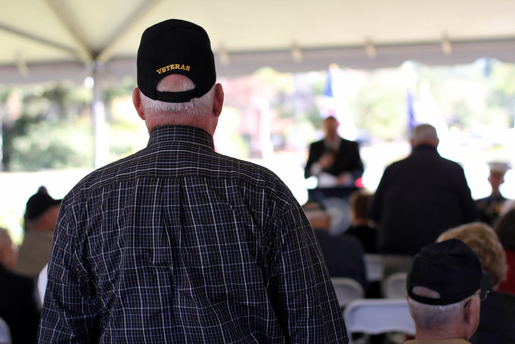 A veteran stands to be recognized for his service