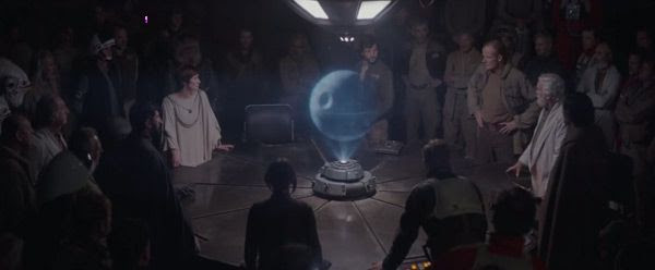 The hologram of the Death Star takes center stage during a Rebel briefing on Yavin 4 in ROGUE ONE: A STAR WARS STORY.