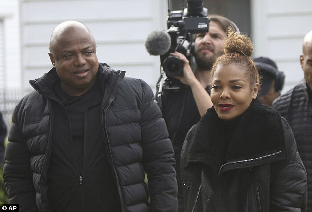 Together again: Janet Jackson and her big brother Randy returned to pay a visit to their tiny former house in Gary, Indiana on Friday