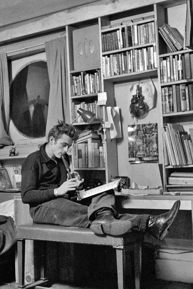 James Dean in his W 68th St NYC Studio apt, I know he's not reading but this IS HIS APT where he lived in the early 50s...look at all those books!!! See google for more fab pics from Life Magazine article