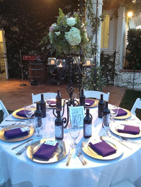 Table setting. Wedding. Purple napkins. Silver chargers